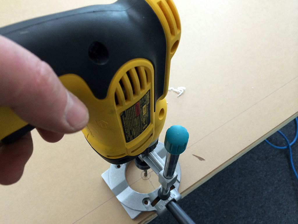 Use a portable drill guide to create holes at precise right angles to the sheet. This will help insure that your acrylic sheet will hang correctly on your mounts.
