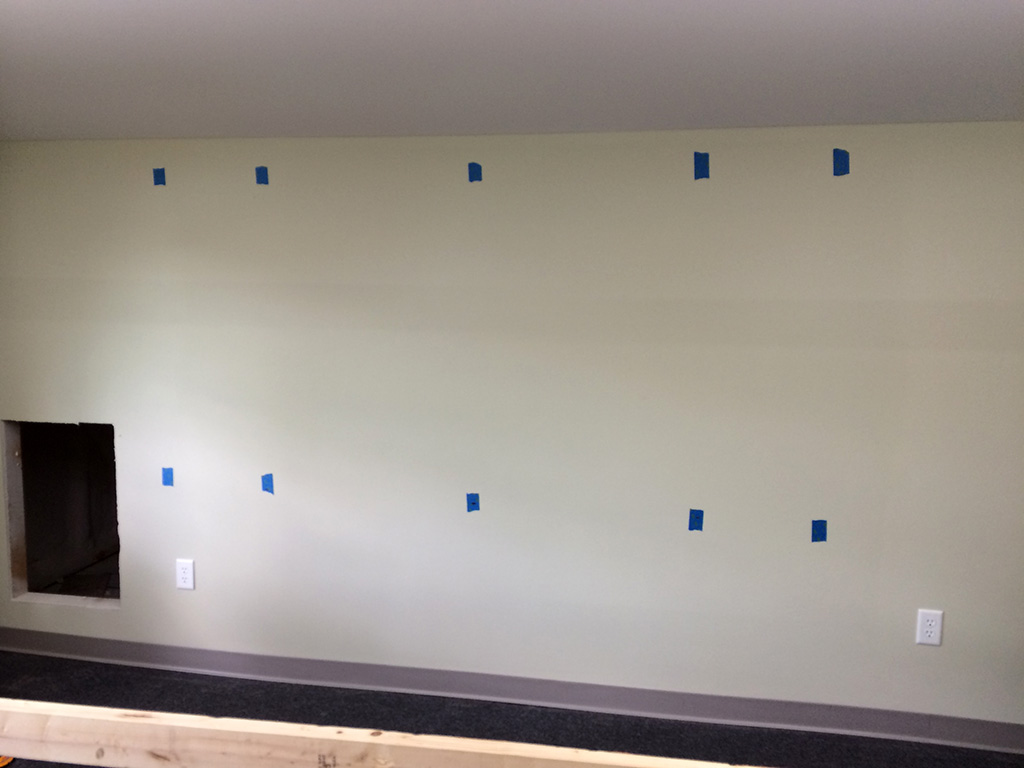 Mark the studs with painter's tape. Be sure the tape is centered over the stud.